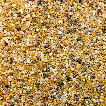 Χαλαζιακή άμμος - Οικοδομικά υλικά Milagro Stone (στη φωτογραφία εικονίζεται χαλαζιακή άμμος η οποία μοιάζει με μικρά στρογγυλεμένα πετραδάκια -όπως αυτά σε μία παραλία- λευκού, κίτρινου και σκούρου καφέ χρώματος)